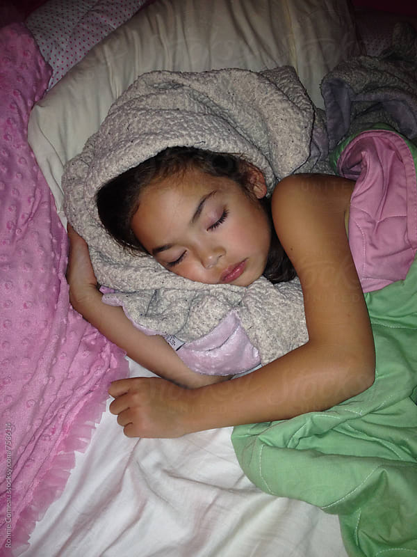 Child Sleeping Wrapped In Blankets by Ronnie Comeau for Stocksy United