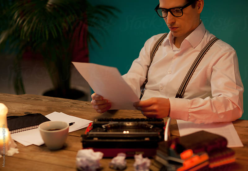 Writer busy at his desk. by Mosuno for Stocksy United