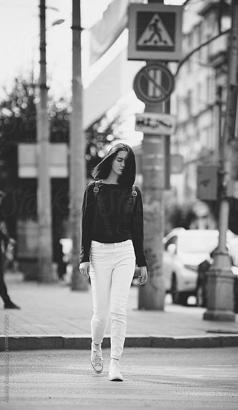 young woman walking on the street. by Vesna for Stocksy United