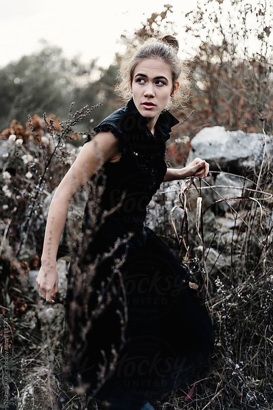 Portraits of a beautiful young woman in nature by Natasa Kukic for Stocksy United