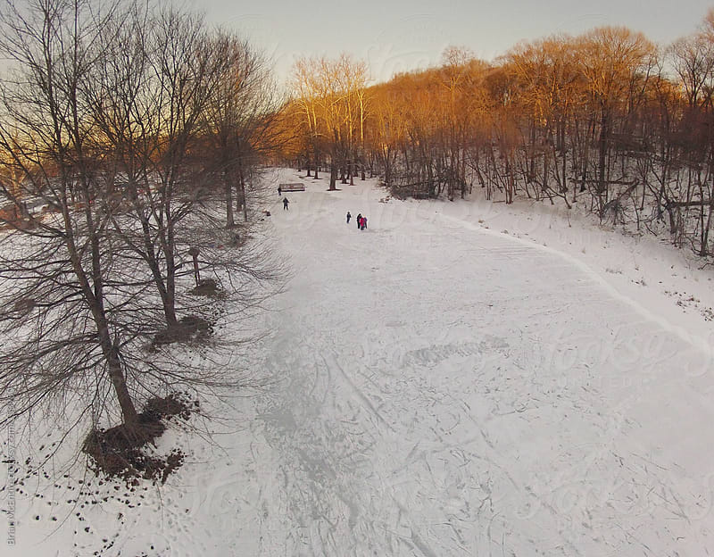 Aerial Sunset View of Ice Skaters and Hockey Players on Rural Po by Brian McEntire for Stocksy United