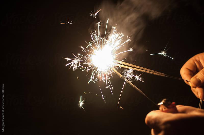 handful of sparklers by Margaret Vincent for Stocksy United