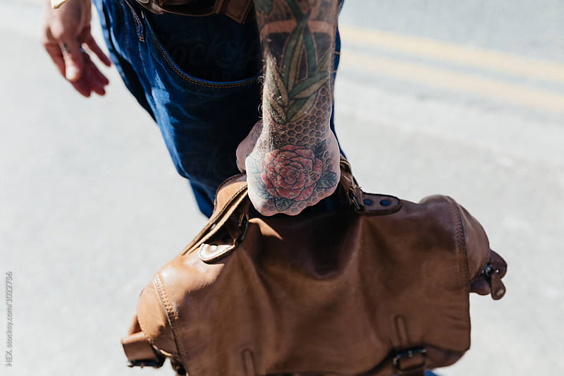 Stylish Old Man With Tattoos Holding a Bag. Detail by HEX. for Stocksy United