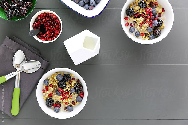 Flat lay of granola with berries by Kirsty Begg for Stocksy United