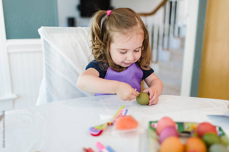 Toddler having fun painting easter eggs by Jakob for Stocksy United