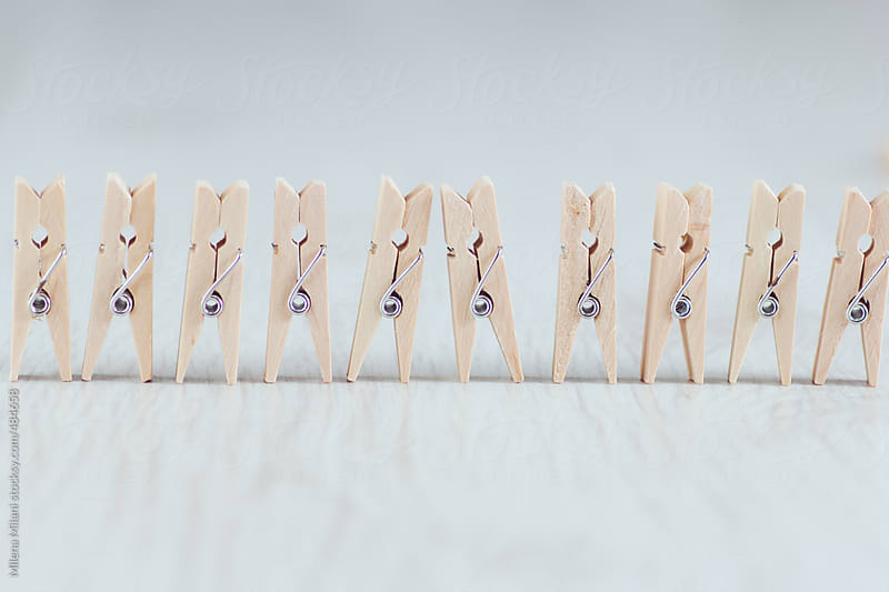 Clothespins in a row by Milena Milani for Stocksy United