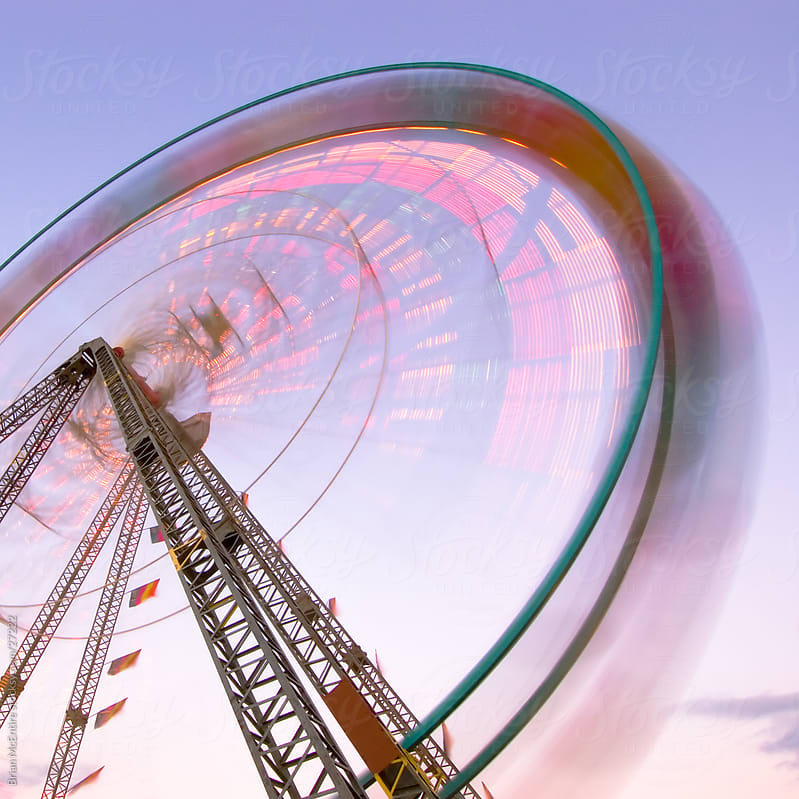 Carnival Ferris Wheel at Dusk with Motion Blur by Brian McEntire for Stocksy United