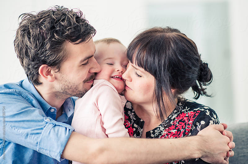 young happy family at home by Andreas Gradin for Stocksy United