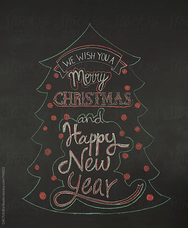 Christmas card on a chalkboard by CACTUS Blai Baules for Stocksy United