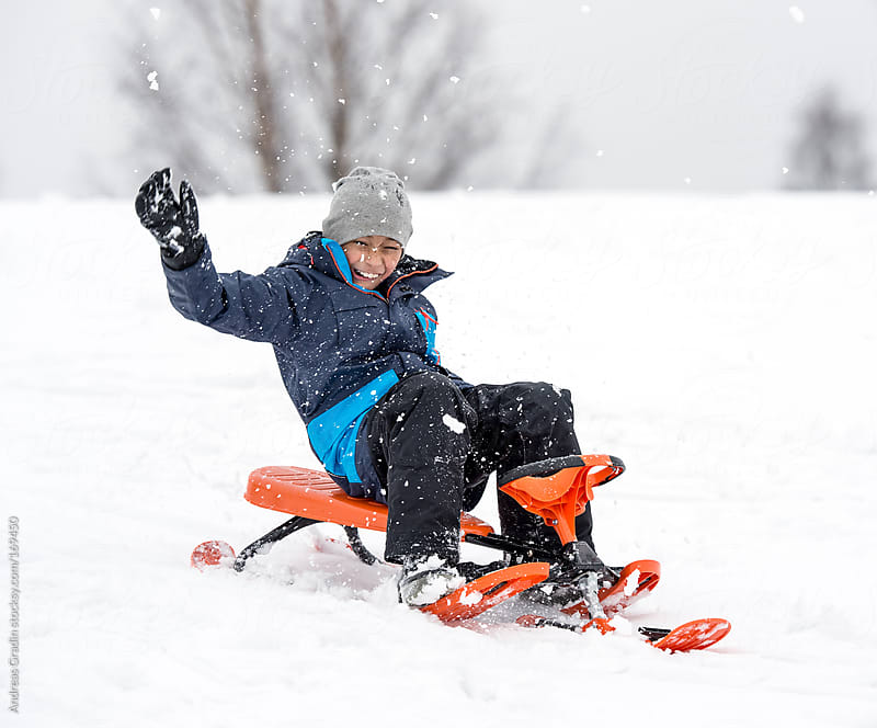 child having fun in the snow  by Andreas Gradin for Stocksy United