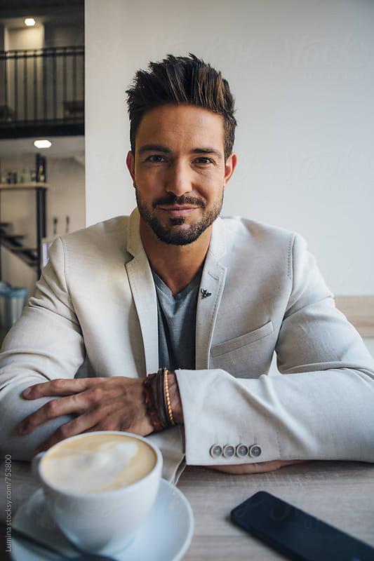 Elegant Man Drinking Coffee at a Cafe by Lumina for Stocksy United