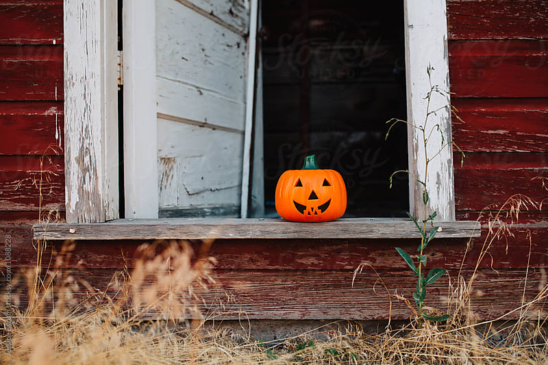 Pumpkin In Doorway by Jessica Byrum for Stocksy United