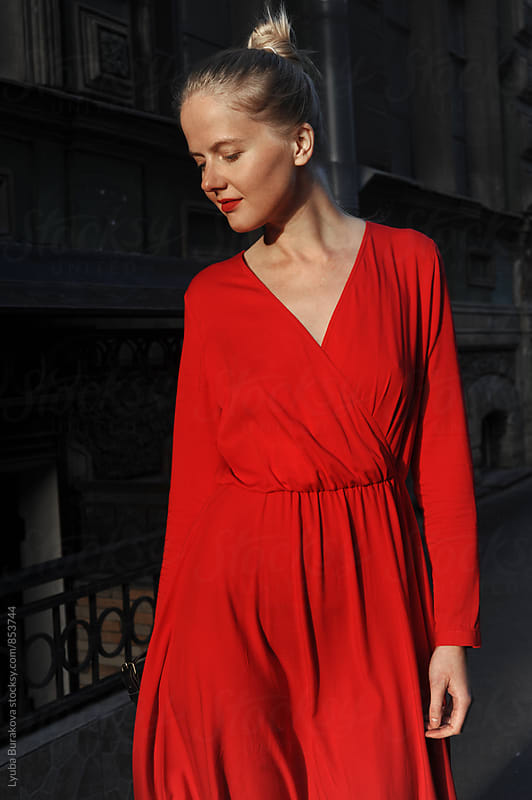 Young woman wearing red dress by Lyuba Burakova for Stocksy United