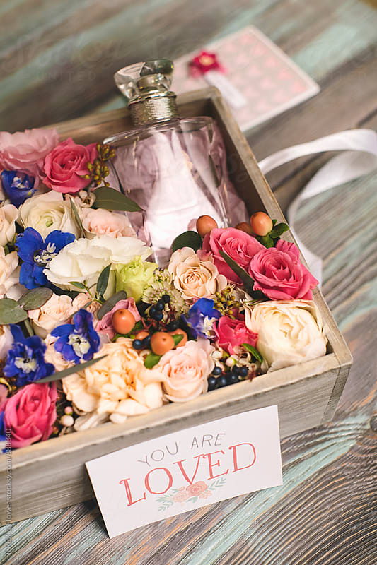Beautiful box with fresh flowers and bottle of perfume by Danil Nevsky for Stocksy United