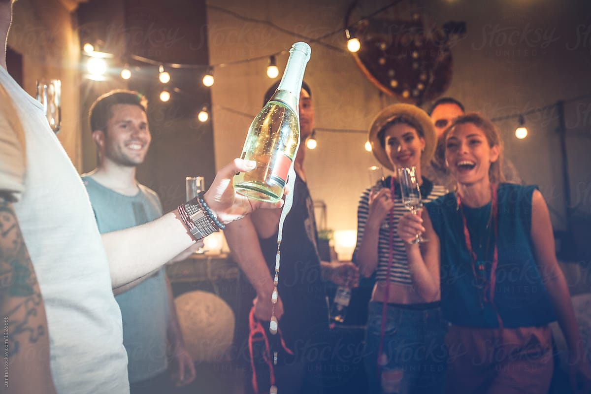 Friends Opening Champagne by Lumina - Celebration, Champagne - Stocksy United