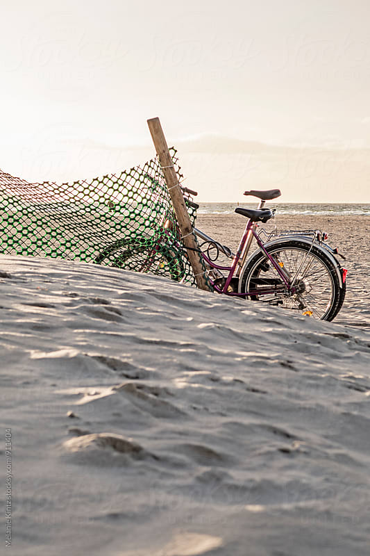 Bicycles parked at the beach by Melanie Kintz for Stocksy United