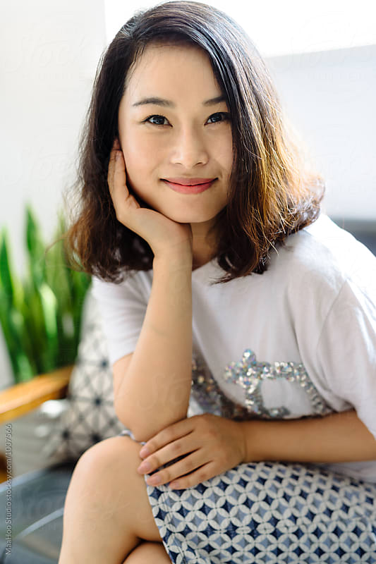 Portrait of young asian woman at home by Maa Hoo for Stocksy United