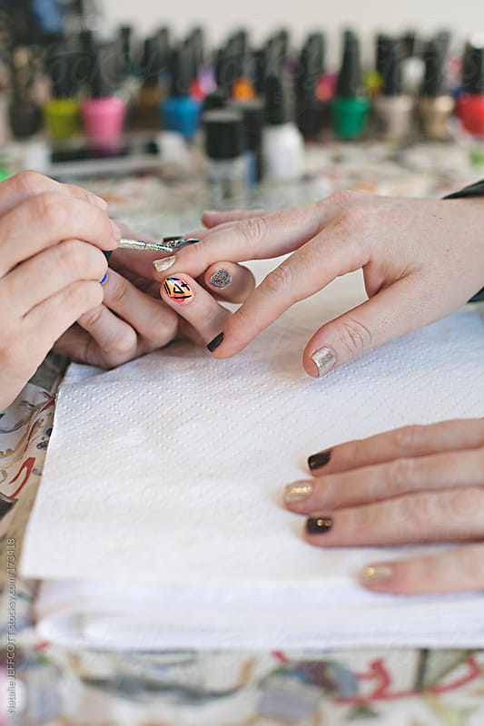 close up of a lady's hand getting her nails done / manicure / nail art by Natalie JEFFCOTT for Stocksy United