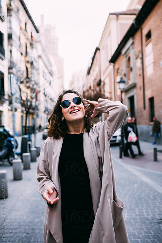 woman wearing sunglasses and smiling  by Thais Ramos Varela for Stocksy United