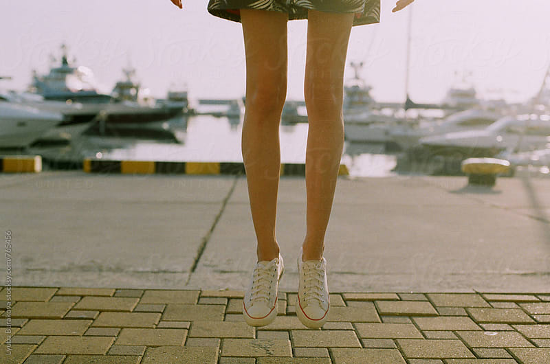 Woman jumping at seaside by Lyuba Burakova for Stocksy United