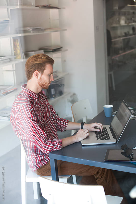 Young Businessman Working at His Laptop by Lumina for Stocksy United