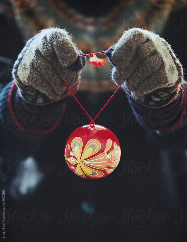 Hanging Christmas baubles by Laura Stolfi for Stocksy United