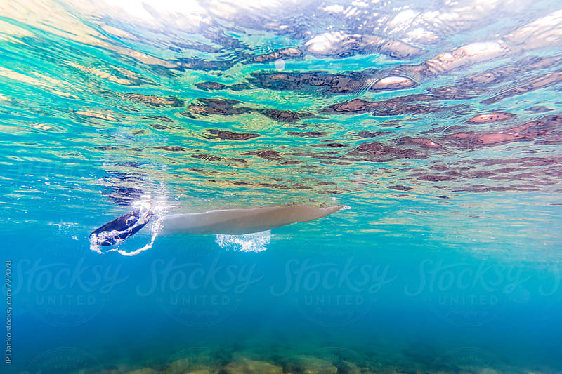 Underwater Photo of Kayaker Paddling with Stroke Vortex in Clear Freshwater Lake at Family Cottage by JP Danko for Stocksy United