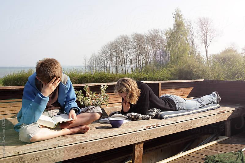 Reading on the veranda by Marcel for Stocksy United