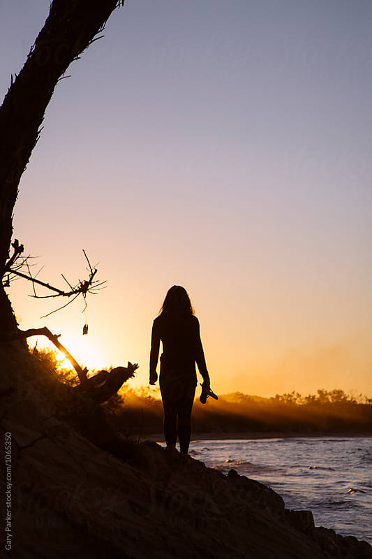 Sunset silhouettes by Gary Parker for Stocksy United