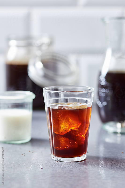 Glass of brew coffee with ice by Martí Sans for Stocksy United