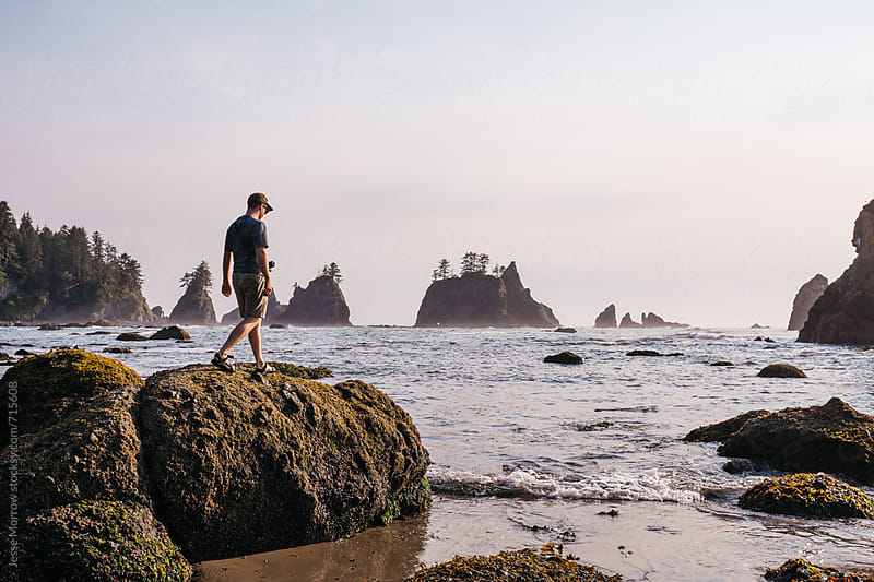 young male exploring west coast rocks in washington by Jesse Morrow for Stocksy United