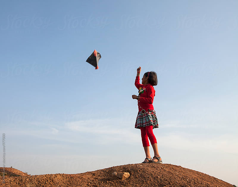 A girl flying kite in rural India by PARTHA PAL for Stocksy United