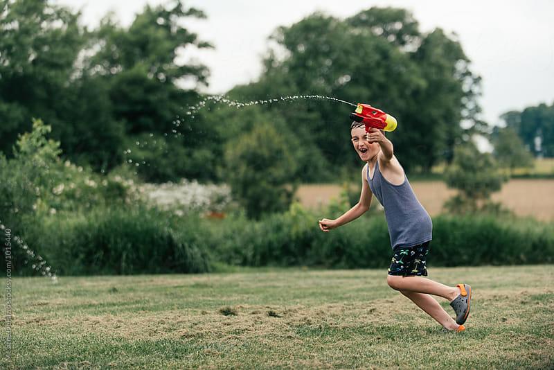 water guns by Melanie DeFazio for Stocksy United