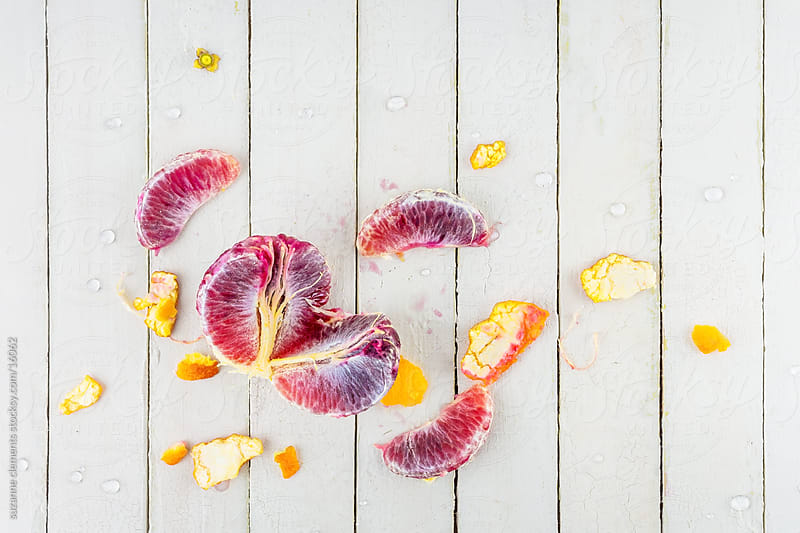 Freshly Peeled Organic Blood Orange by suzanne clements for Stocksy United