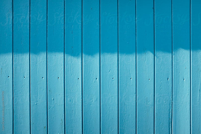Blue wooden panelled beach hut. Norfolk, UK. by Liam Grant for Stocksy United