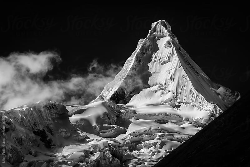 Dramatic view of Alpamayo in black and white by Mick Follari for Stocksy United