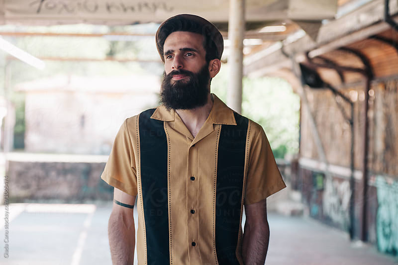 Portrait of a man with beard by Giada Canu for Stocksy United