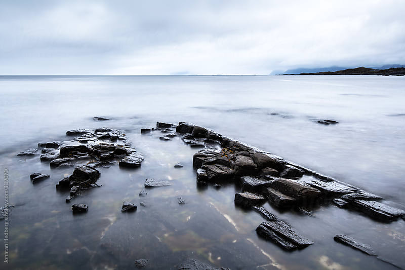 A long exposure of rock formations in the water by Jonatan Hedberg for Stocksy United