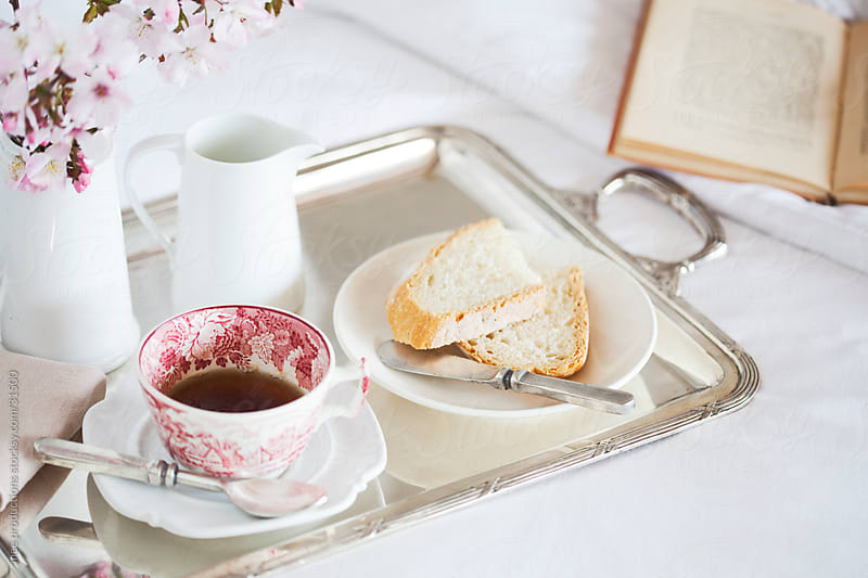 Breakfast in bed, tea, bread and literature by mee productions for Stocksy United