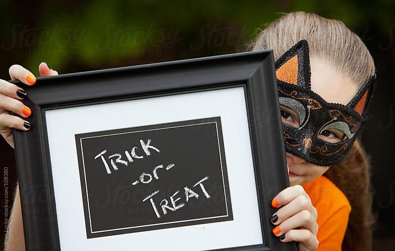 Halloween: Cat Girl Child Holding Halloween Message by Sean Locke for Stocksy United