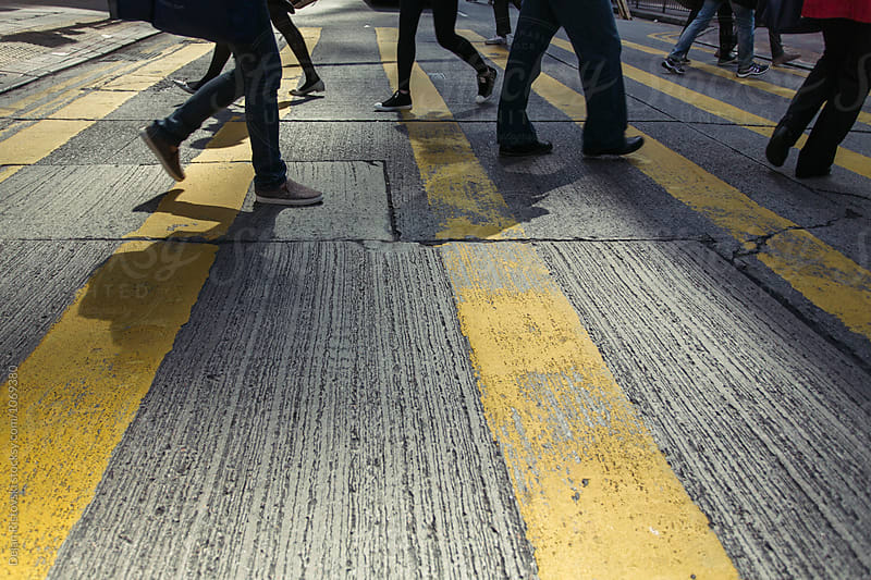 A crowded  crosswalk  by Dejan Ristovski for Stocksy United