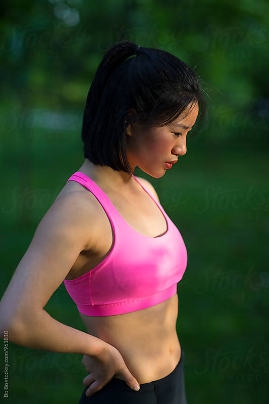 young asian woman resting after running by Bo Bo for Stocksy United