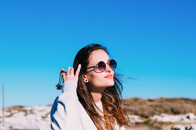 Young woman with sunglasses by Susana Ramírez for Stocksy United
