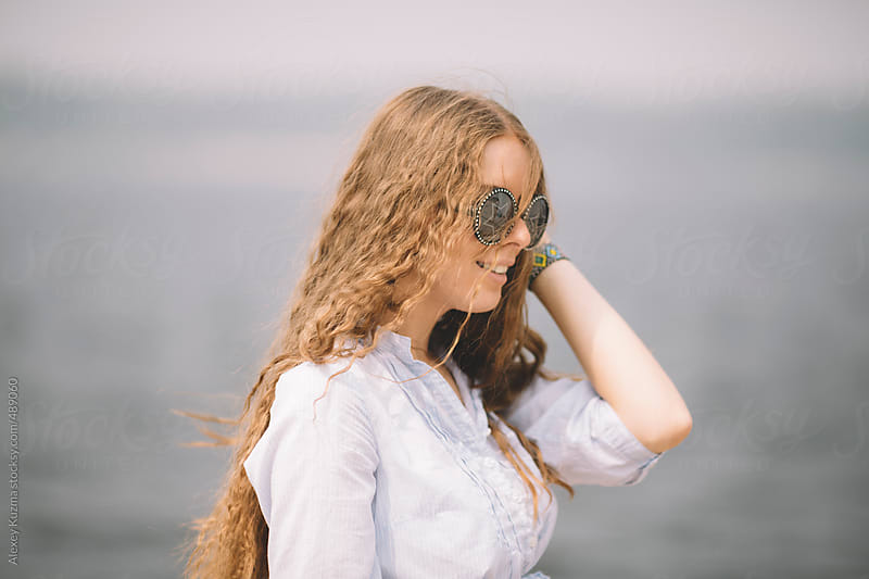 happy young woman enjoy the summer day on the sea by Alexey Kuzma for Stocksy United