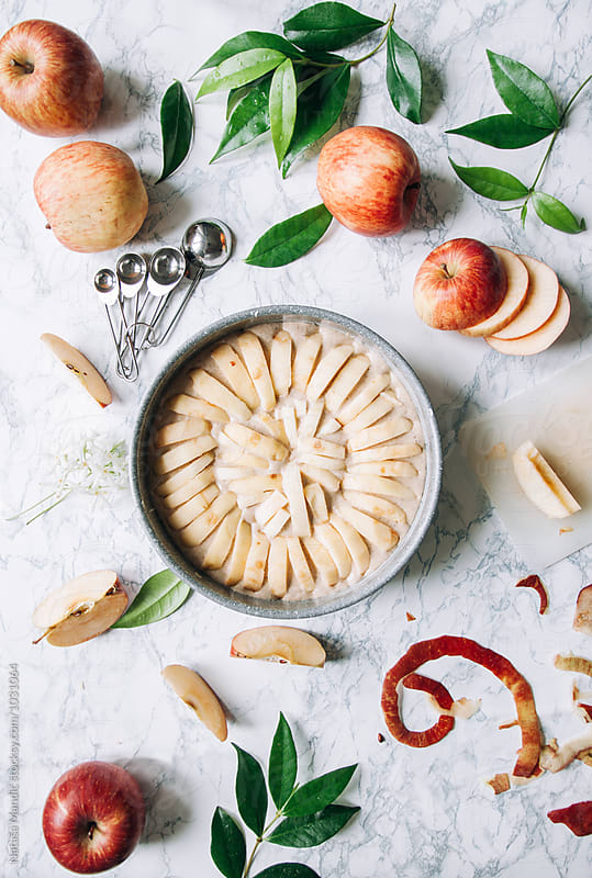Preparing an apple cake by Nataša Mandić for Stocksy United