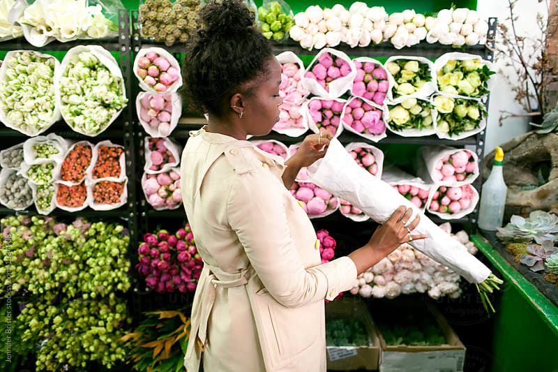 Woman shopping for flowers in flower shop