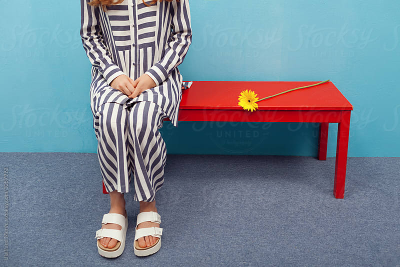 conceptual image of woman wearing stripe clothes by Ulaş and Merve for Stocksy United