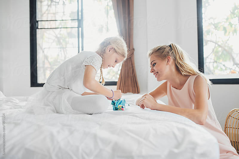 Mother and daughter having fun at home by Lumina for Stocksy United