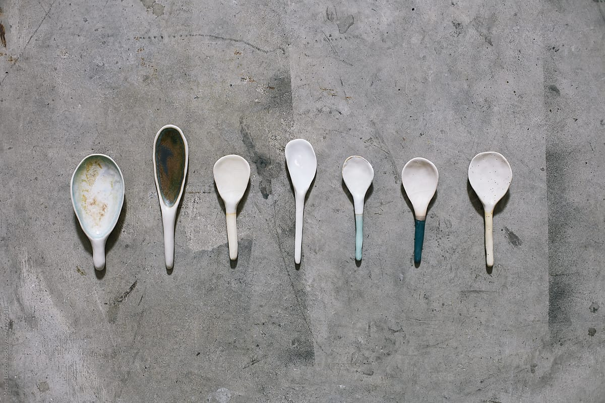 Set Of Craft Ceramic Spoons On A Concrete Floor By Miquel Llonch Stocksy United