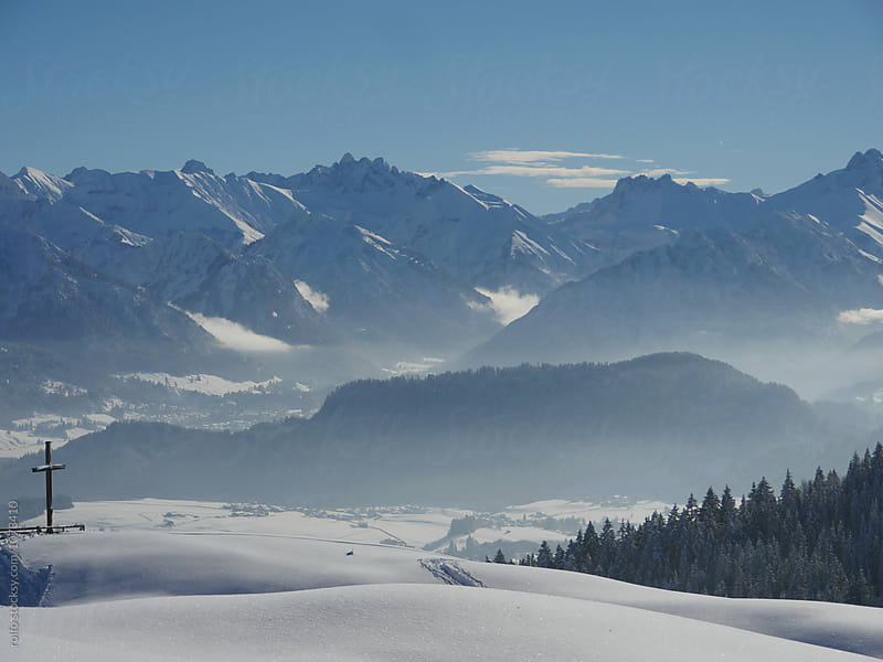 Calm scene of mountain summit in winter by rolfo for Stocksy United